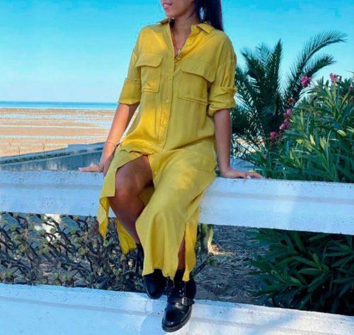 vista lateral de vestido camisero amarillo midi